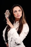 Portrait of beautiful girl  with bird on the hand Stock Images
