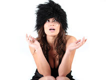 Portrait of a beautiful girl with black hat. Royalty Free Stock Images