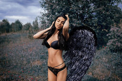 Portrait of a beautiful girl with black wings a demon Stock Photo