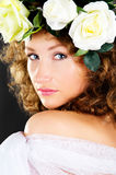 Portrait of a beautiful girl with a bouquet of flowers on the he Royalty Free Stock Image