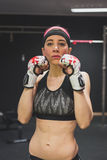 Portrait of a beautiful girl with boxing gloves Stock Image