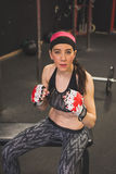 Portrait of a beautiful girl with boxing gloves Stock Photo