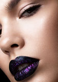 Portrait of a beautiful girl. Brilliant glossy lips closeup. Purple glitter on black lipstick Royalty Free Stock Photos
