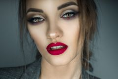Portrait of beautiful girl with brown eyes and red lips looking Royalty Free Stock Photo