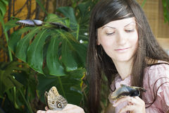 Portrait of beautiful girl with butterfly Stock Photo