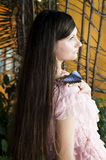 Portrait of beautiful girl with butterfly in a greenhouse Royalty Free Stock Images