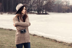 Portrait of a beautiful girl with the camera in a hat Royalty Free Stock Photos