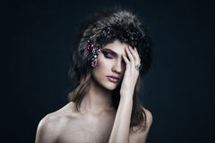 Portrait of a beautiful girl in a cap of black fox. Stock Photos