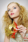 Portrait of beautiful girl with carnival mask Stock Photos