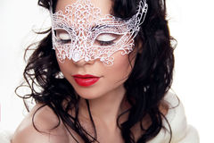 Portrait of beautiful girl in Carnival mask on face  on Stock Photography