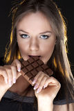 Portrait of beautiful girl with a chocolate Royalty Free Stock Photography