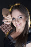 Portrait of beautiful girl with a chocolate Stock Photography