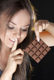 Portrait of beautiful girl with a chocolate stock photo