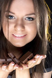 Portrait of beautiful girl with a chocolate royalty free stock photos