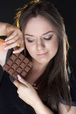 Portrait of beautiful girl with a chocolate Royalty Free Stock Photo