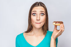 Portrait of beautiful girl with chocolate donuts. Stock Images