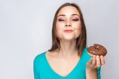 Portrait of beautiful girl with chocolate donuts. Royalty Free Stock Photo