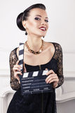 Portrait of beautiful girl with cinema clapperboard Royalty Free Stock Photo