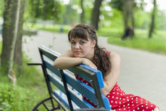 Portrait of beautiful girl in city park. Stock Photo