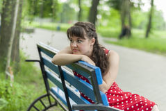 Portrait of beautiful girl in city park. Stock Image