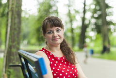 Portrait of beautiful girl in city park. Stock Images