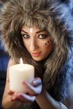 Portrait of beautiful girl close up in the attire of an Indian America. With a candle in his hand Royalty Free Stock Photo