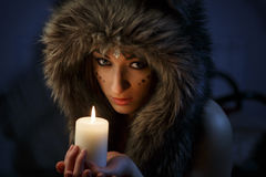 Portrait of beautiful girl close up in the attire of an Indian America. With a candle in his hand Royalty Free Stock Images