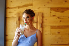 Portrait of a beautiful girl in a cofee with a glass of cappuccino Royalty Free Stock Photos