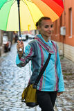 Portrait of beautiful girl with a colofurl umbrella Royalty Free Stock Photography