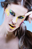 Portrait of a beautiful girl with a color make-up Stock Photos