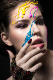 Portrait of a beautiful Girl with color paint on her face. Beauty face Royalty Free Stock Images