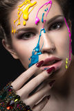 Portrait of a beautiful Girl with color paint on her face. Beauty face Royalty Free Stock Photography