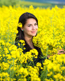 Portrait of a beautiful girl in the colza field in summer Royalty Free Stock Photos