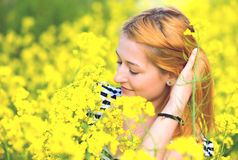 Portrait of a beautiful girl in the colza field in summer Royalty Free Stock Photography