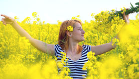 Portrait of a beautiful girl in the colza field in summer Royalty Free Stock Photo