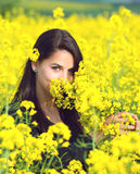 Portrait of a beautiful girl in the colza field in summer Royalty Free Stock Images