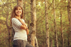 Portrait of a beautiful girl in the coniferous forest Royalty Free Stock Images