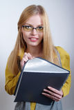 Portrait of beautiful girl with copybook Stock Image