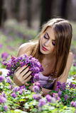 Portrait of a beautiful girl. In corydalis Stock Image