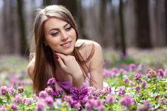 Portrait of a beautiful girl. In corydalis Royalty Free Stock Image