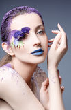 Portrait of a beautiful girl with a creative make-up Stock Photography