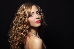Portrait of a beautiful girl with curly hair Stock Images