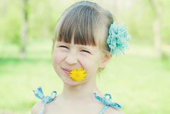 Portrait of Beautiful girl with dandelion. Stock Photo