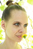 Portrait of a beautiful girl with a dandelion. Portrait of a beautiful girl with a yellow dandelion Stock Photo