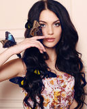 Portrait of beautiful girl with dark hair with butterflies Royalty Free Stock Photos