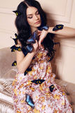 Portrait of beautiful girl with dark hair with butterflies Royalty Free Stock Images