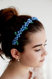 Portrait of beautiful girl with dark hair and light porcelain skin. Hair in a bun.Hair accessory handmade Stock Images
