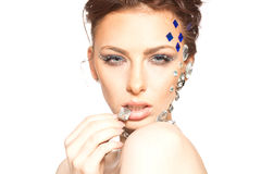 Portrait of beautiful girl with diamonds on her face Royalty Free Stock Image
