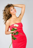 Portrait of beautiful girl in dress with rose Royalty Free Stock Images