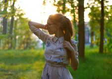 Portrait of a beautiful girl in a dress at sunset. Girl in the S Stock Photo